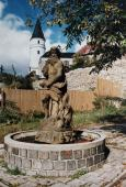 Historie sochy Neptuna v pozadí zámek